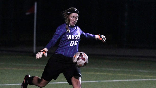 Mason keeper Toni Bizzarro punts the ball off for the Comets.