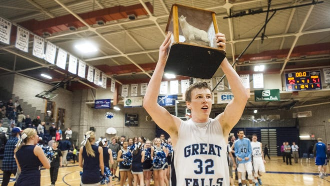 Brendan Howard carries Ole Goat after Great Falls beat Havre 52-51 in the Swarthout Fieldhouse on Thursday.