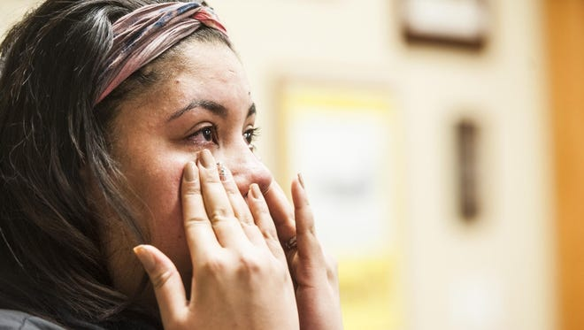 Denisse Willis cries Friday while recounting her experience with Technical Sgt. Sean Russell and Staff Sgt. Joseph Stalzer helping to save her 18-month-old baby Aryanna Willis.