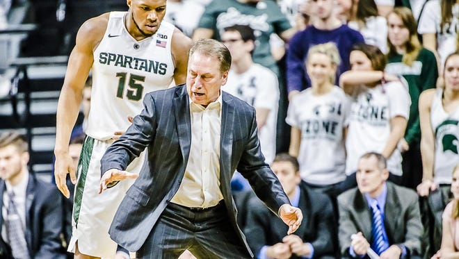 MSU coach Tom Izzo instructs Marvin Clark after Clark was charged with a foul during Sunday's game against Rutgers. Clark played eight minutes, scored two points and pulled down five rebounds.