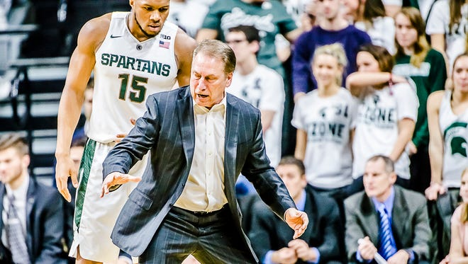 MSU Men's Basketball Head Coach Tom Izzo ,right, instructs Marvin Clark after Clark was charged with a foul during their game with Rutgers.