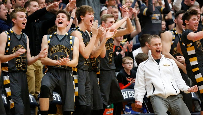 Coach Domask and members of the Waupun High School boys basketball team react to a Waupun basket against Ripon High School Thursday, March 10, 2016, at West Bend West High School during their WIAA Sectional game in West Bend, Wisconsin. Waupun won the match up 59-49 and will advance to finals Saturday in Whitefish Bay for a chance to get to state.Doug Raflik/USA TODAY NETWORK-Wisconsin