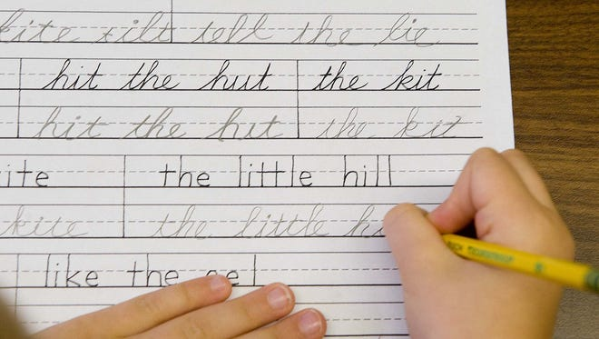 Students practice both printing and cursive handwriting skills in the six to nine year old's classroom at the Mountaineer Montessori School in Charleston, W.Va. Wednesday, Sept. 16, 2009. (AP Photo/Bob Bird)