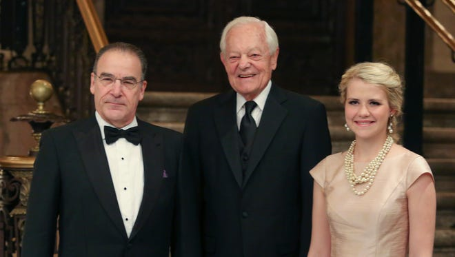 Honorees (from left) Mandy Patinkin, Bob Schieffer and Elizabeth Smart pose for photos during a reception for the 37th annual Common Wealth Awards for Distinguished Service at the Hotel DuPont Saturday.
