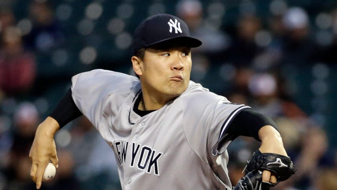 New York Yankees starting pitcher Masahiro Tanaka, of Japan, throws to the Baltimore Orioles in the first inning of a baseball game in Baltimore, Thursday, May 5, 2016.