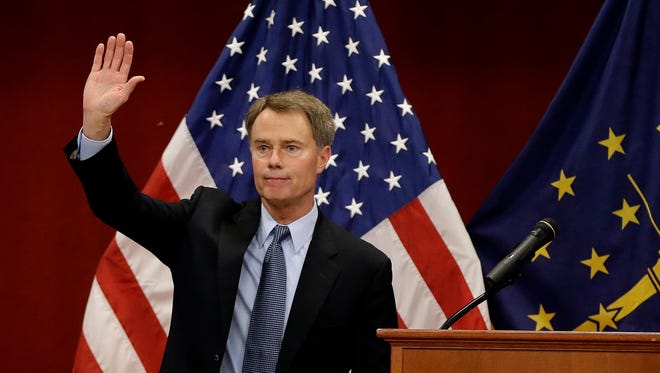 Mayor Joe Hogsett waves to the crowd gathered after delivering his first State of the City address at the Christamore House on the near westside of Indianapolis on May 11, 2016.