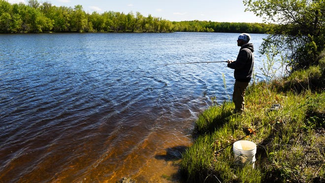 Robert Burns, Albany, fishes along the bank of the Mississippi River Sunday, May 15, near the boat access at Mississippi River County Park.