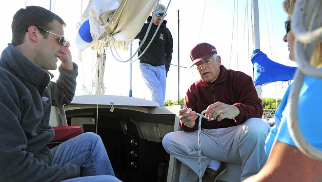 """Kenny Cooper instructs Mark Storolis, left, Walt Kloeppel and Annette Rackley in knot tying and the art of sailing at Percy Priest Yacht Club's """"Learning at the Helm'' program."""