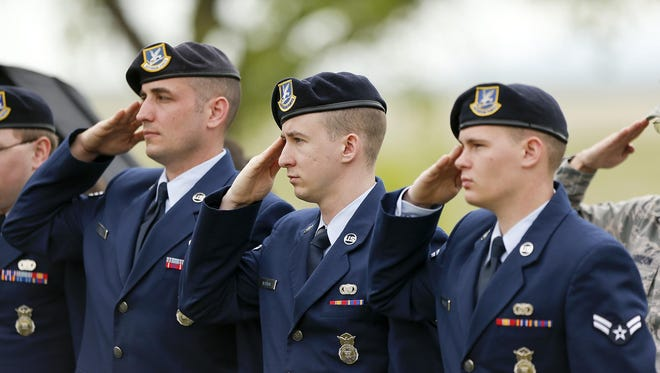 From left, Senior Airman Derek Forte, Airman 1st Class Richard Noonan and Airman 1st Class Brad Norberg give a salute. Veterans, active duty and government representatives will be on hand for Monday's ceremony at the Montana Veterans Memorial.