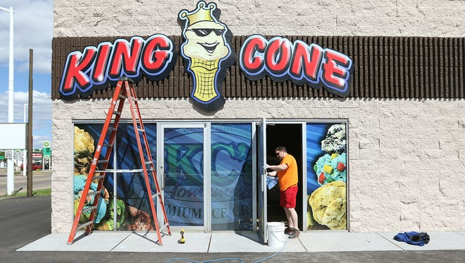 King Cone owner Ben Klosinski works on getting the new King Cone location ready in Wisconsin Rapids, Tuesday, May 17, 2016. King Cone is located at 1621 Baker Street.