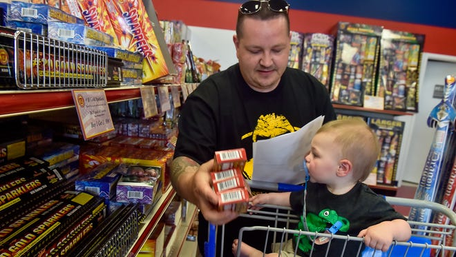 Jerry Smith, from Chambersburg, looks at a list and puts some pop-pop snappers in his cart while shopping at Keystone Fireworks off of Molly Pitcher Highway in Greencastle on Thursday June 29, 2016. Smith bought fireworks and poppers for his family to play with during the Fourth of July holiday weekend.