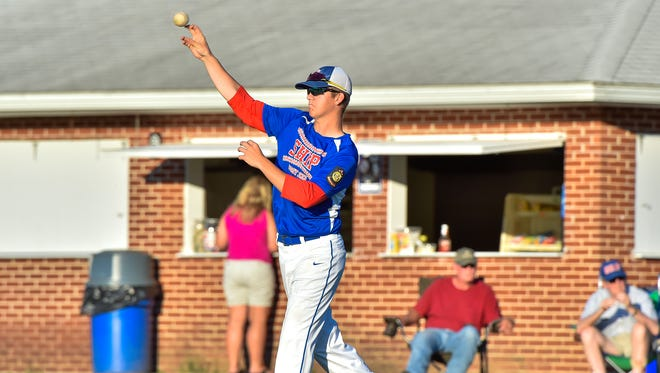 Shippensburg's Brock Dull throws ball to his teammate while warming up between innings during the Franklin County American Legion playoffs. Dull was in a severe dirt bike accident last summer, but returned to Post 223 this season.     baseball game against Waynesboro on Saturday, July 9, 2016.