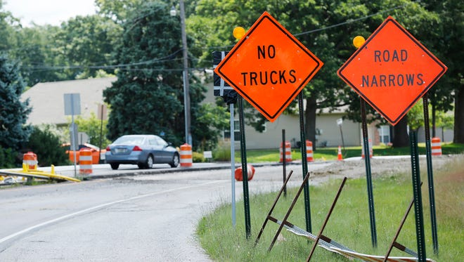Traffic moves slowly in a single lane on Happy Hollow Road Tuesday, July 19, 2016, in West Lafayette. The City of West Lafayette is considering changing rules for semitrailer traffic, with certain exceptions, through residential areas.