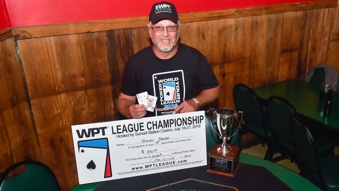 Steven Spencer poses with his trophy and check on Wednesday, August, 2, 2016 at Dilly's in Chambersburg, Pa. Spencer won the World's Poker Tour league's Texas Hold 'Em tournament.