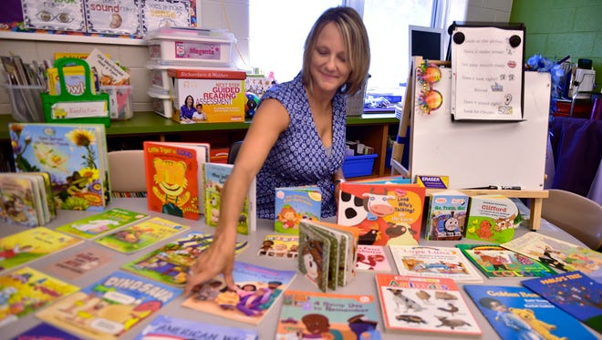 Teacher Amy Osbaugh gets reading materials ready for students in her kindergarten class Tuesday, August 16, 2016 at Ben Chambers Elementary School. School starts Thursday in the Chambersburg Area School District.