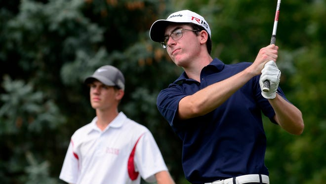 Logan Snyder of Dover, left, watches as Zach Dixon of Eastern York tees off on the par three 14th hole during the York-Adams Division II golf match at Bon Air Country Club, Thursday, August 25, 2016. Dixon shot the round's low score of 77. John A. Pavoncello photo