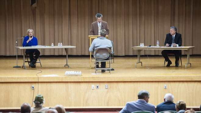 Kristen Juras, left, and Dirk Sandefur, right, debate for a Montana Supreme Court position at West Elementary on Thursday.