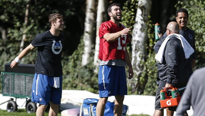 Indianapolis Colts quarterback Andrew Luck (12) laughs with the other quarterbacks during practice at The Grove in London on Sept. 30, 2016.