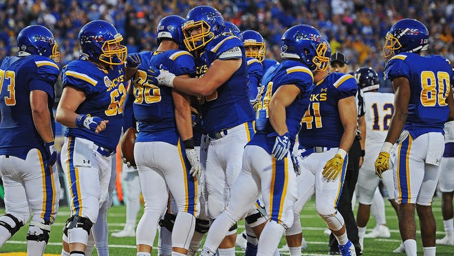SDSU's Dallas Goedert (86) reacts with teammates after scoring a touchdown during a game against Western Illinois Saturday, Oct. 1, 2016, at Dana J. Dykhouse Stadium on the South Dakota State University campus in Brookings, S.D.