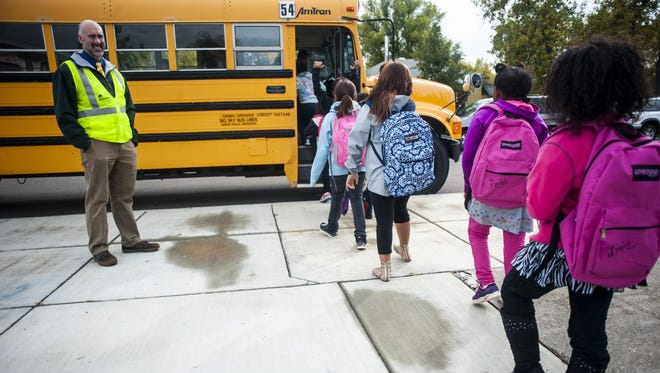 Students board a bus outside Longfellow Elementary on Tuesday afternoon. Both the high school and elementary bond levies passed, and a new school is planned to replace Longfellow, which has major foundational issues.