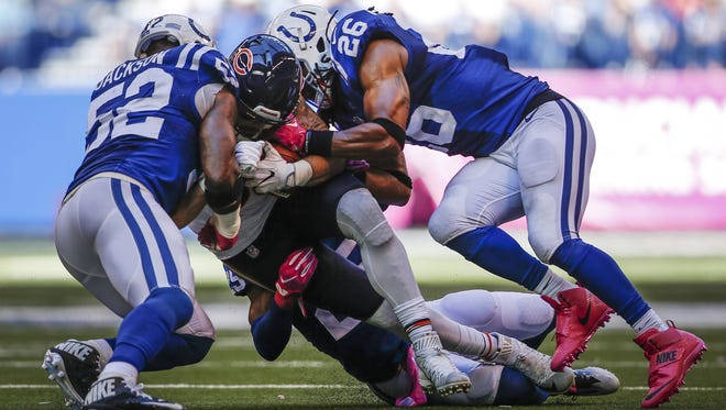 Indianapolis Colts inside linebacker D'Qwell Jackson (52), cornerback Patrick Robinson (25) and free safety Clayton Geathers (26) lay a hit on Chicago Bears tight end Zach Miller (86) at Lucas Oil Stadium on Oct. 9, 2016.