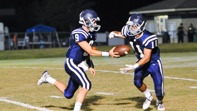 Caleb Prudhomme hands off to Cole Fournet as the Westminster Crusaders take on Basile Bearcats. October 13, 2016.