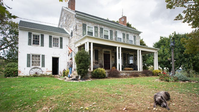 The Mifflin House, in Hellam Township, with its a brick summer kitchen at left, is in jeopardy of being demolished. Historic preservationists, noting its connection to the Underground Railroad, want it saved.