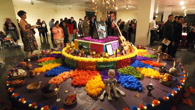 A large altar to the late Mexican singer and composer Juan Gabriel was unveiled Tuesday night at the El Paso Museum of Art. The round altar, sponsored by the Consulate General of Mexico in El Paso features photographs, musical instruments, CDs, food items and flameless candles. As part of the Día de los Muertos tradition in Mexico, an altar is constructed to celebrate the memory of a loved one who has died. Marcos Bucio, Consul General of Mexico in El Paso, attended the event and was introduced by Tracey Jerome, director of Museums and Cultural Affairs Department for El Paso. Juan Gabriel died August 28. The altar unveiling was in conjunction with an exhibit called Hermosos Huesos by Las Cruces native Wayne Hilton. Día de los Muertos is Nov. 2.