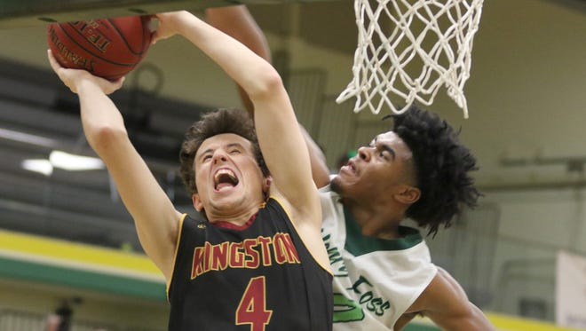Kingston's Kainoa Saffery, left, is stopped en route to the basket against Foss during Wednesday's Class 2A West Central District semifinal game.