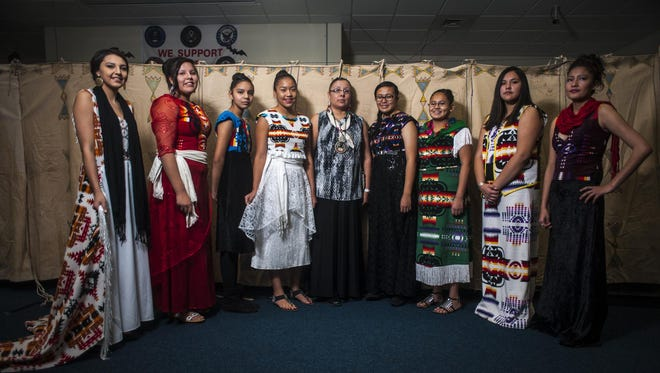 Belinda Bullshoe, center, is photographed with local models wearing her designs last year.