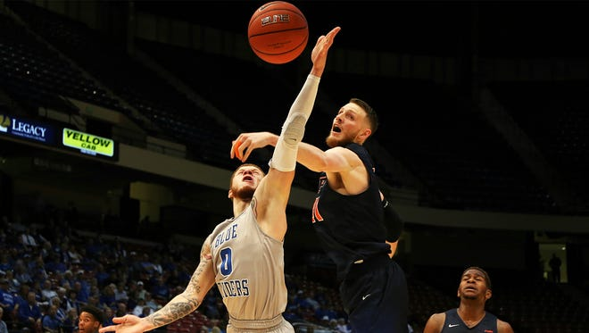 UTEP center Matt Willms battles for the ball with Tyrik Dixon, 0, of Middle Tennessee Friday at Birmingham, AL.