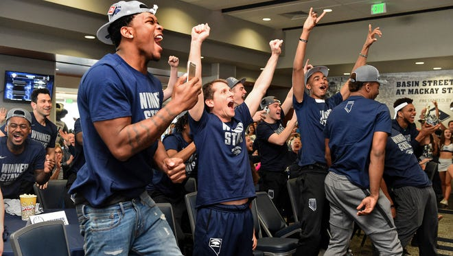 The Wolf Pack basketball team celebrates after learning it will face Iowa State in the first round of the NCAA Tournament.