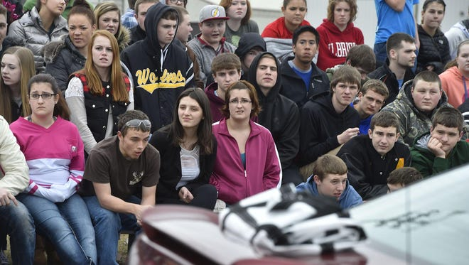 Algoma High School students look on with shock and dismay at the accident scene.