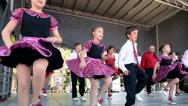 Cloggers with Rocky Top Revue perform at the 33rd annual Main Street Festival in downtown Franklin on April 23, 2016.