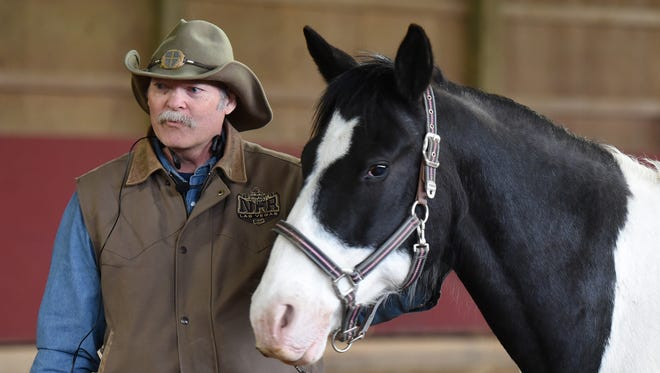 Don Rach-St. Clair talks about the story behind his horse Zoro during the April 29 Cowboy Church at his Miracle Ranch stables and farm in Milford Township. Rach-St. Clair, his wife Karen and Dominic Francese of Oak Point Church teamed up for an entertaining and spiritual look at God through horseback riding, showmanship and the bond of man and horse.
