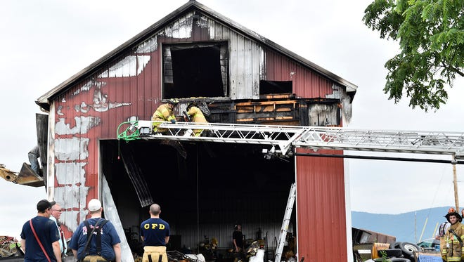 Firefighters extinguished a fire at a large shed Thursday, June 15, 2017 in the 1800 block of Pioneer Drive, St. Thomas. The fire was reported around 5:30 a.m. The fire is under investigation by a state police fire marshal.