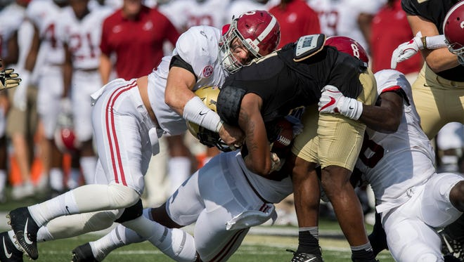 Alabama linebacker Keith Holcombe (42) and linebacker Dylan Moses (8) stop Vanderbilt wide receiver Kalija Lipscomb (16) on a kick return at Vanderbilt Stadium in Nashville, Tenn. on Saturday September 23, 2017. (Mickey Welsh / Montgomery Advertiser)