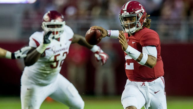 Alabama quarterback Jalen Hurts (2) throws against Arkansas in first half action at Bryant Denny Stadium in Tuscaloosa, Ala. on Saturday October 14, 2017. (Mickey Welsh / Montgomery Advertiser)