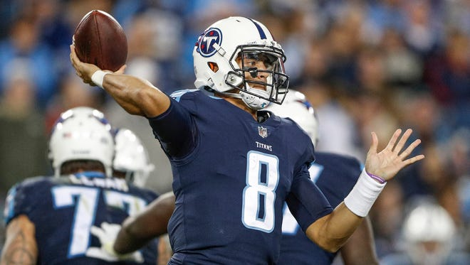 Tennessee Titans quarterback Marcus Mariota (8) drops back to throw against the Indianapolis Colts at Nissan Field in Nashville, Tenn., on Monday, Oct. 16, 2017. The pass would be intercepted by Indianapolis Colts outside linebacker John Simon (51) and returned for a touchdown.