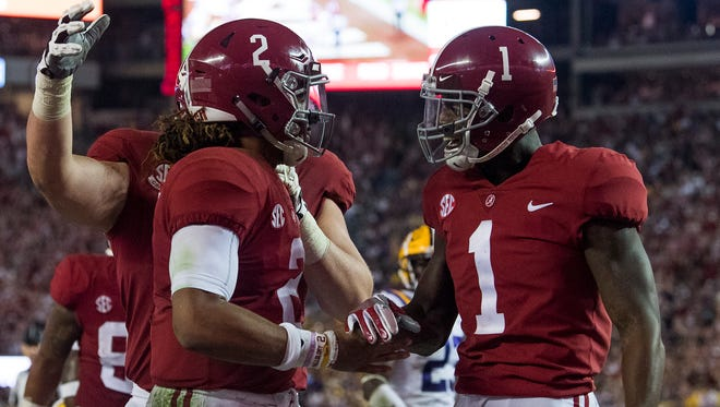 Alabama quarterback Jalen Hurts (2) and Alabama wide receiver Robert Foster (1) after Hutrts scored a secoond half touchdown against LSU at Bryant Denny Stadium in Tuscaloosa, Ala. on Saturday November 4, 2017.