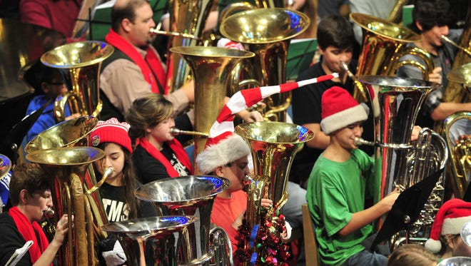 The annual Merry Tuba Christmas, with 100 tubas playing Christmas Carols, at First Baptist Church is one of the highlights of the holiday season