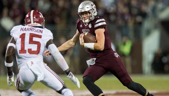 Mississippi State quarterback Nick Fitzgerald (7) carries