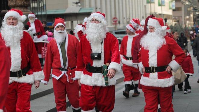 Santas will make their way through Downtown Cincinnati as they take part in Santacon Convention, based around a pub crawl..