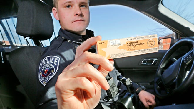 Officer Zach Johnson displays nasal spray Wednesday, December 6, 2017, outside Lafayette Police Department headquarters. The rise of heroin and overdoses influenced LPD's decision to outfit its 90 uniformed police officers with the lifesaving drug.