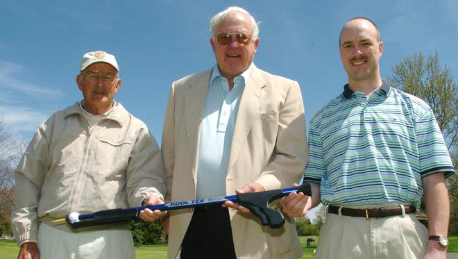 (From left) Roger Gay, Pres Kool and Brandon Hultink show off the Kool Tee product on Thursday afternoon at Battle Creek Country Club in 2002.