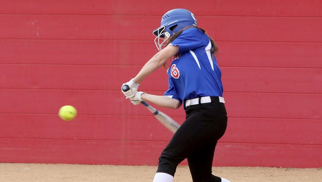 Graham's Morgan Patterson makes contact with the ball in the game against Burkburnett Friday, March 23, 2018, in Graham.