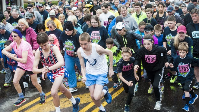 Runners begin the one mile race during the 38th annual Ice Breaker in 2017.