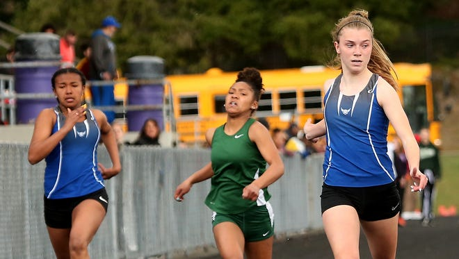 Olympic's Hanna Troy (right) won the 100 meters at Saturday's Lil' Norway Invitational in Poulsbo in a meet-record time of 12.5 seconds.