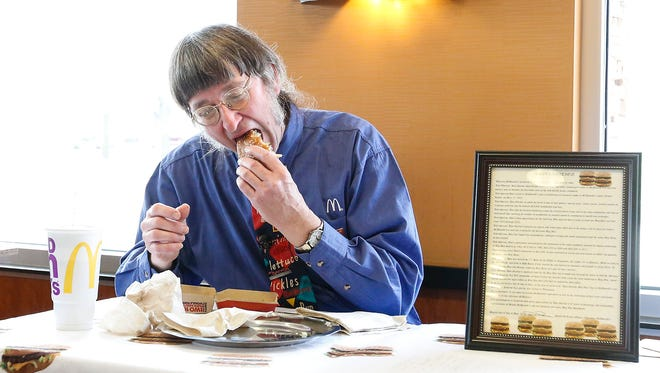 Don Gorske of Fond du Lac eats his 30,000th Big Mac sandwich Friday, May 4 at the Military Road McDonald's in Fond du Lac.