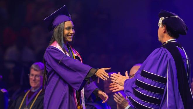 Emily Bencosme graduates from Northwestern State University May 11, 2018.